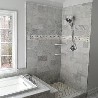 Standing shower and tub remodel with beautiful marble tile.
